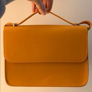I'm selling a yellow/orange purse!